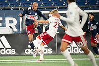 FOXBOROUGH, MA - OCTOBER 16: Tiago Mendonca #33 of New England Revolution II controls a high ball as Thomas Roberts #23 of North Texas SC defends during a game between North Texas SC and New England Revolution II at Gillette Stadium on October 16, 2020 in Foxborough, Massachusetts.