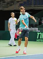 Switserland, Genève, September 17, 2015, Tennis,   Davis Cup, Switserland-Netherlands, Roger Federer practise, in the background captain Severin Luthi<br /> Photo: Tennisimages/Henk Koster