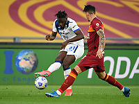 Football, Serie A: AS Roma - Atalanta Olympic stadium, Rome, April 22, 2021. <br /> Atalanta's Duvan Zapata (l) in action with Roma's Roger Ibanez (r) during the Italian Serie A football match between AS Roma and Atalanta at Rome's Olympic stadium, Rome, on April 22, 2021.  <br /> UPDATE IMAGES PRESS/Isabella Bonotto