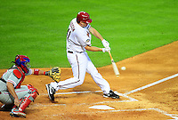 Apr. 26, 2011; Phoenix, AZ, USA; Arizona Diamondbacks pitcher Daniel Hudson hits a two RBI double in the second inning against the Philadelphia Phillies at Chase Field. Mandatory Credit: Mark J. Rebilas-