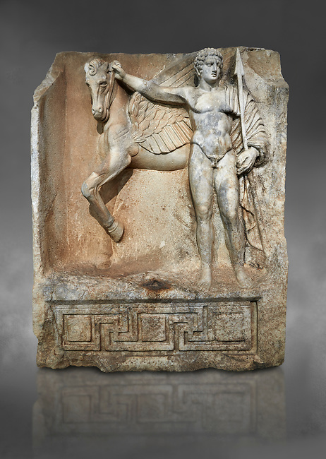 "Roman Sebasteion relief  sculpture of  Bellerophon Aphrodisias Museum, Aphrodisias, Turkey. Against a grey background.<br /> <br /> Bellerophon was a Lykian hero and was claimed as a founder of Aphrodisias. He holds his winged horse Pegasos. The deign was modelled on another relief panel in the series ""Royal hero with Dod Hunting"". The carving is poor and the sculptor may have been a novice.modelled"