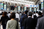People wearing protective masks walk through a train station during the morning rush hour in Tokyo, Japan on May 26, 2020, on the first day after the Japanese government lifted a coronavirus state of emergency. (Photo by Naoki Morita/AFLO)