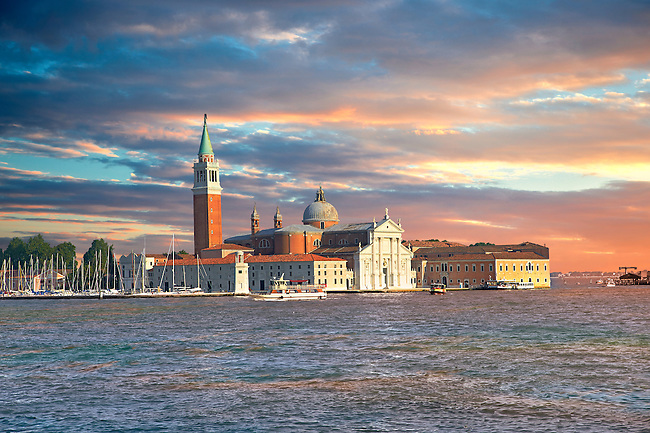 The island of San Giorgio Maggiore lying east of the Giudecca and south of the main island group, with its church front designed by Andrea Palladio and begun in 1566.  Venice Italy