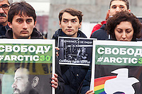 """Moscow, Russia, 05/10/2013.<br /> Greenpeace activists hold posters asking """"A journalist not a pirate"""" and portraits of the crew members of the ship """"Arctic Sunrise"""" in a demonstration in their support. The entire crew and accompanying journalists have been charged with piracy after being seized at gunpoint by Russian coastguards while protesting at a Gazprom off-shore drilling platform In the Arctic."""