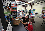 Jill Scofield, with the Nevada Beef Council, teaches Micah Smith, 4, about beef during the annual Farm Days event at Fuji Park in Carson City, Nev., on Thursday, April 17, 2014.<br /> Photo by Cathleen Allison