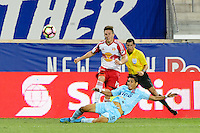 Harrison, NJ - Thursday Sept. 15, 2016: Alex Muyl, Juan Carlos Portillo during a CONCACAF Champions League match between the New York Red Bulls and Alianza FC at Red Bull Arena.