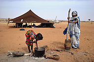 December 1978, Mauritania. Young girls born into slavery work all day long cooking and  making matts in the area of Boutlimit, Mauritania. Child slaves are not allowed an education and are forced to work their entire life.   - Child labor as seen around the world between 1979 and 1980 - Photographer Jean Pierre Laffont, touched by the suffering of child workers, chronicled their plight in 12 countries over the course of one year.  Laffont was awarded The World Press Award and Madeline Ross Award among many others for his work.