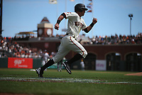 SAN FRANCISCO, CA - APRIL 6:  Joe Panik #12 of the San Francisco Giants runs the bases against the Tampa Bay Rays during the game at Oracle Park on Saturday, April 6, 2019 in San Francisco, California. (Photo by Brad Mangin)