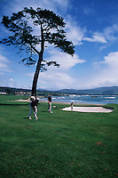 Scenic view of golfers at the Pebble Beach golf course. Carmel, California.