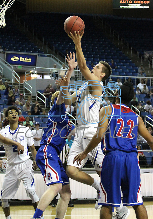 Bishop Gorman's Zach Collins shoots over Reno defender David Kyle during the NIAA Division I state basketball tournament in Reno, Nev. on Thursday, Feb. 25, 2016. Gorman won 70-39. Cathleen Allison/Las Vegas Review-Journal