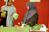 Buying fruit and vegetables at a weekly Food Co-op shop at the Aberfeldy Neighbourhood Centre, Tower Hamlets, London..