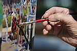 18 October 2009: New Zealand artist Peter Williams does work at Keeneland on Sunday October 18. Williams is known for his vibrant oil paintings that are started and completed on location.