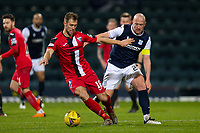 19th December 2020; Dens Park, Dundee, Scotland; Scottish Championship Football, Dundee FC versus Dunfermline; Steven Whittaker of Dunfermline Athletic holds the ball as Charlie Adam of Dundee tries to challenge