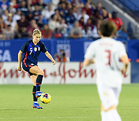 FRISCO, TX - MARCH 11: Abby Dahlkemper #7 of the United States gathers in a loose ball against Japan during a game between Japan and USWNT at Toyota Stadium on March 11, 2020 in Frisco, Texas.