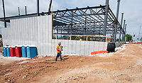 Construction continues Tuesday June 8, 2021 at the University of Arkansas School of Art Windgate Studio and Design Center building at the corner of Martin Luther King Blvd. and Hill Ave. in Fayetteville. The building will be ready for students and faculty in the fall of 2022. There will be studios, critique and gallery spaces and nontraditional classrooms. The project was paid for with a 40 million dollar gift from the Windgate Charitable Foundation. Visit nwaonline.com/2100609Daily/ and nwadg.com/photo. (NWA Democrat-Gazette/J.T. Wampler)