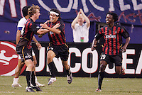 The MetroStars' Sergio Galvan Rey putting the MetroStars up 2-1 with teammates  Eddie Gaven and Fabian Taylor. The Colorado Rapids defeated the NY/NJ MetroStars 3 to 2 at Giant's Stadium, East Rutherford, NJ, on June 30, 2004.