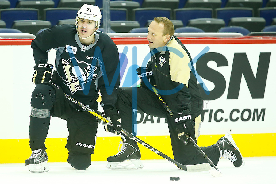 Evgeni Malkin #71 of the Pittsburgh Penguins talks with Sergei Gonchar during the morning skate at the Verizon Center in Washington D.C. on April 28, 2016. (Photo by Jared Wickerham / DKPS)