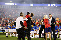 CHARLOTTE, NC - OCTOBER 3: Ali Krieger #11 of the United States hugs her brother while being honored for playing 100 games for the national team during a game between Korea Republic and USWNT at Bank of America Stadium on October 3, 2019 in Charlotte, North Carolina.