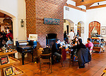 Visitors to Barboursville Vineyards relax with their wine and snacks in front of the fireplace outside the tasting room.