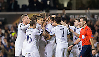 Teammates mob goalscorer Mousa Dembele of Tottenham Hotspur as he scores the winner during the UEFA Europa League Group J match between Tottenham Hotspur and R.S.C. Anderlecht at White Hart Lane, London, England on 5 November 2015. Photo by Andy Rowland.