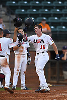 Jacob Berry (15) (LSU) of Team Stars is greeted at home plate after hitting a home run during a game against Team Stripes on July 6, 2021 at Pioneer Park in Greeneville, Tennessee. (Tracy Proffitt/Four Seam Images)