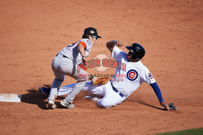 Mesa Solar Sox third baseman Jeimer Candelario (6) is tagged out by shortstop Chan Jong Moon (39) sliding into second during an Arizona Fall League game against the Glendale Desert Dogs on October 14, 2015 at Sloan Park in Mesa, Arizona.  Glendale defeated Mesa 7-6.  (Mike Janes/Four Seam Images)