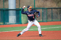 Kenny Towns (9) of the Virginia Cavaliers makes a throw to second base during infield practice prior to the game against the Hartford Hawks at The Ripken Experience on February 27, 2015 in Myrtle Beach, South Carolina.  The Cavaliers defeated the Hawks 5-1.  (Brian Westerholt/Four Seam Images)