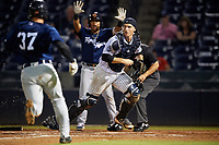 Tampa Tarpons catcher Kellin Deglan (25) fields a throw as Andres Sthormes (37) scores a run with Isaac Paredes (background) directing traffic and umpire Brandon Mooney (hidden) looking on during the second game of a doubleheader against the Lakeland Flying Tigers on May 31, 2018 at George M. Steinbrenner Field in Tampa, Florida.  Lakeland defeated Tampa 3-2.  (Mike Janes/Four Seam Images)