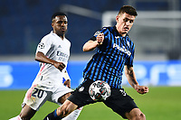 Joackim Maehle of Atalanta BC and Vinicius Junior of Real Madrid during the Champions League round of 16 football match between Atalanta BC and Real Madrid at Atleti azzurri d'Italia stadium in Bergamo (Italy), February, 24th, 2021. Photo Image Sport  / Insidefoto