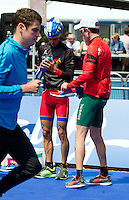 31 MAY 2014 - LONDON, GBR - Mario Mola (ESP) (centre) of Spain talks with Richard Murray (RSA) (right) of South Africa as Jonathan Brownlee (GBR) (left) of Great Britain warms up in transition before the start of the  men's 2014 ITU World Triathlon Series round in Hyde Park in London, Great Britain (PHOTO COPYRIGHT © 2014 NIGEL FARROW, ALL RIGHTS RESERVED)