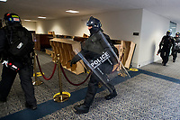 Members of a Secret Service tactical team arrive as Senators evacuate to a safe place in the Dirksen Senate Office Building after Electoral votes being counted during a joint session of the United States Congress to certify the results of the 2020 presidential election in the US House of Representatives Chamber in the US Capitol in Washington, DC on Wednesday, January 6, 2021, as interrupted as thousands of pr-Trump protestors stormed the U.S. Capitol and the House chambers.  .<br /> Credit: Rod Lamkey / CNP/AdMedia