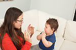7 month old baby boy interaction with mother hand gestures and singing