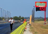 Sept. 24, 2011; Ennis, TX, USA: NHRA crew member for funny car driver Melanie Troxel during qualifying for the Fall Nationals at the Texas Motorplex. Mandatory Credit: Mark J. Rebilas-