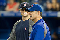 Boston Red Sox pitcher Jon Lester #31 talks with John Farrell before an American League game against the Toronto Blue Jays at Rogers Centre on June 3, 2012 in Toronto, Ontario.  (Mike Janes/Four Seam Images)