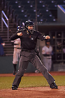 Umpire Jae-Young Kim calls a batter out on strikes during a Midwest League game between the Wisconsin Timber Rattlers and Lansing Lugnuts at Cooley Law School Stadium on May 2, 2019 in Lansing, Michigan. Lansing defeated Wisconsin 10-4. (Zachary Lucy/Four Seam Images)