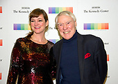 Jacque D'Amboise and his daughter-in-law, Kelly D'Amboise arrive for the formal Artist's Dinner honoring the recipients of the 40th Annual Kennedy Center Honors hosted by United States Secretary of State Rex Tillerson at the US Department of State in Washington, D.C. on Saturday, December 2, 2017. The 2017 honorees are: American dancer and choreographer Carmen de Lavallade; Cuban American singer-songwriter and actress Gloria Estefan; American hip hop artist and entertainment icon LL COOL J; American television writer and producer Norman Lear; and American musician and record producer Lionel Richie.  <br /> Credit: Ron Sachs / Pool via CNP