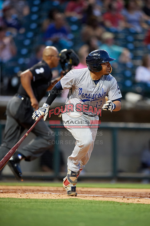 Pensacola Blue Wahoos catcher Chadwick Tromp (13) runs to first base as home plate umpire Jose Navas follows the play during a game against the Birmingham Barons on May 8, 2018 at Regions Field in Birmingham, Alabama.  Birmingham defeated Pensacola 5-2.  (Mike Janes/Four Seam Images)