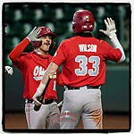Brent Todys (12) of the Ohio State Buckeyes, left, is greeted after scoring an insurance run in the 13th inning of a 6-3 win over the Illinois Fighting Illini on Friday, March 5, 2021, at Fluor Field at the West End in Greenville, South Carolina. (Tom Priddy/Four Seam Images)