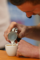 MELBOURNE, 18 MAY 2014 - Christian Ullrich from Germany competing in the final of the 2014 World Latte Art Championship at the Melbourne Show Grounds in Melbourne, Australia. Ullrich won the championship from Chiara Bergonzi of Italy and Edit Juhasz of Hungary. Photo Sydney Low /  asteriskimages.com
