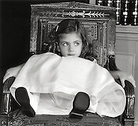 Girl in chair wearing party dress