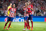 Atletico de Madrid's Filipe Luis, Antoine Griezmann and Koke Resurreccion celebrating a goal during UEFA Champions League match between Atletico de Madrid and Chelsea at Wanda Metropolitano in Madrid, Spain September 27, 2017. (ALTERPHOTOS/Borja B.Hojas)
