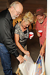 """From left: Larry Peyton, Rhonda Rodriguez and Marvin Peyton at the """"Strung Out"""" backyard barbecue at the Winter Street Studios Saturday July 24,2010.(Dave Rossman/For the Chronicle)"""