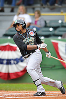 Yasiel Balaguert #22 of the Kane County Cougars swings against the Clinton LumberKings at Ashford University Field on July 5, 2014 in Clinton, Iowa. The Cougars won 4-0.   (Dennis Hubbard/Four Seam Images)