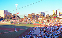 """Ballparks: Sacramento Raley Field. Game time, 7:05 PM, mid-July. To left, """"Money Store""""--stepped pyramid; to right, Bridge to I-80."""