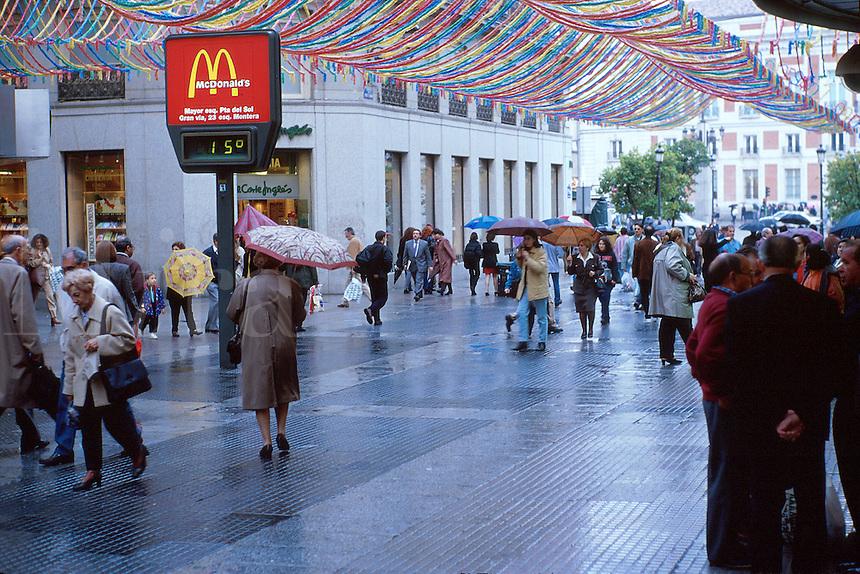 Sign for McDonald s restaurant showing temperature in degrees celsius on pedestrian shopping street Calle de Preciadas near Puerta del Sol. Madrid, Spain.