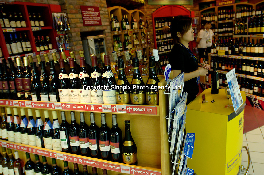 French wines are on sale with a promotion in a Carrefour supermarket in Beijing, China. Major international chains like Carrefour and Walmart Stores have expanded aggressively in China. Local Chinese retailers have loudly protested this and lobbied heavily for protection from the new competition in price and service that these major retailers have set off..22 Jul 2006