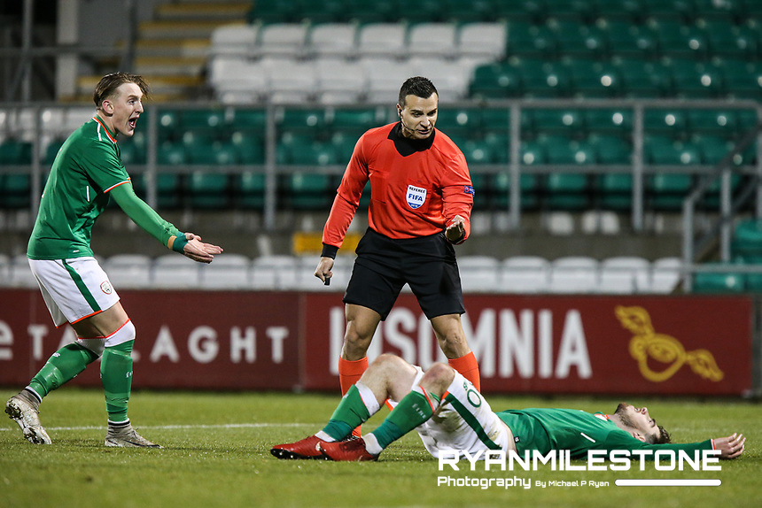 Referee Filip Glova signals to play on to Republic of Ireland's Ryan Manning during the 2019 UEFA Under 21 European Qualifying Round between the Republic of Ireland and Azerbaijan on Tuesday 27th March 2018 at Tallaght Stadium, Dublin. Photo By Michael P Ryan