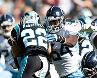 CHARLOTTE, NC - NOVEMBER 3: Rashaan Evans #54 of the Tennessee Titans tackles Christian McCaffrey #22 of the Carolina Panthers during a game between Tennessee Titans and Carolina Panthers at Bank of America Stadium on November 3, 2019 in Charlotte, North Carolina.