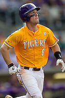 LSU Tigers shortstop Alex Bregman (8) runs to first base during the Southeastern Conference baseball game against the Texas A&M Aggies on April 25, 2015 at Alex Box Stadium in Baton Rouge, Louisiana. Texas A&M defeated LSU 6-2. (Andrew Woolley/Four Seam Images)
