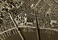 historical aerial photograph of the Brooklyn and Manhattan bridges, the East river waterfront and piers, New York City, 1954